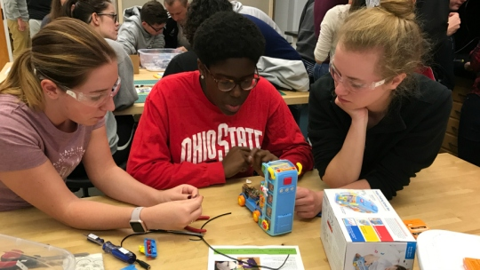 Students at the Ohio State University TAPS program work on modifying a toy.