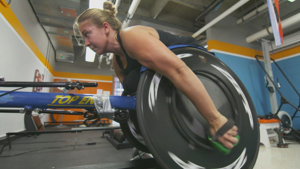 University of Illinois wheelchair racer Arielle Rausin tests out her 3D-printed racing gloves.