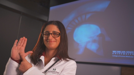 Michigan State University's Dr. Mona Hanna-Attisha pointing to Flint on her hand