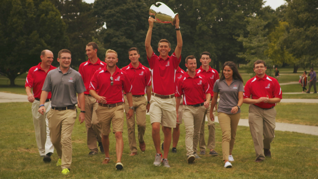 Members of the Ohio State University Center for Aviation Studies lift the Grover Loening Trophy