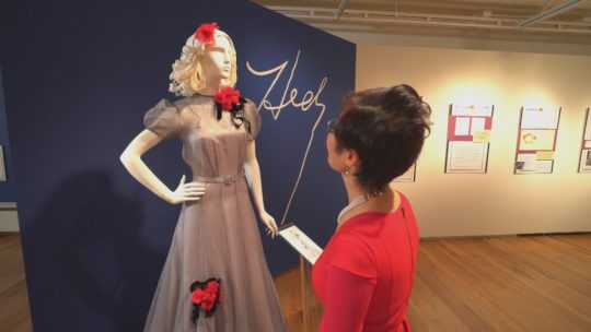 University of Wisconsin dean Soyeon Shim looks at a dress designed by Holocaust victim Hedy Strnad.