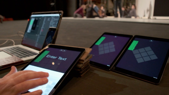 University of Illinois professor John Toenjes is using these mobile devices and tablets to allow the audience to interact with his new dance performance piece.