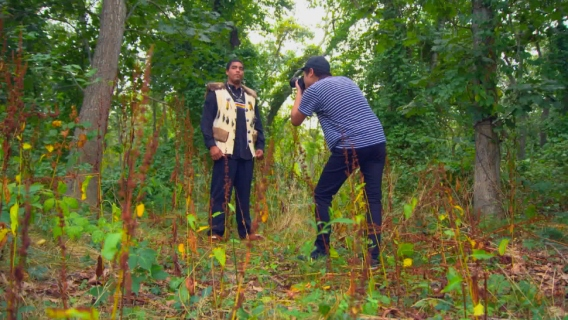 Penn State grad Jeremy Dennis taking a photo of a Shinnecock man on the Shinnecock reservation