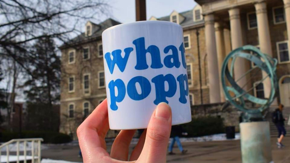A branded mug from Penn State student's event listing startup What'sPoppin
