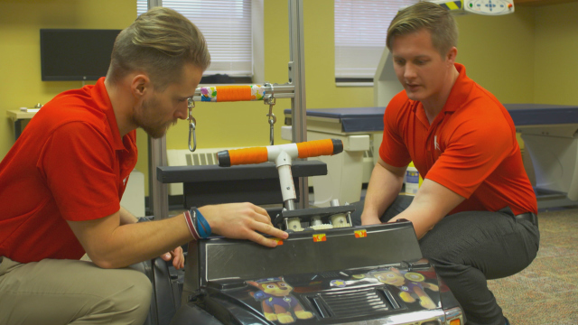 GoBabyGo@IU co-founders Michael Mohr and Andrew Wiseman working on a modified car.