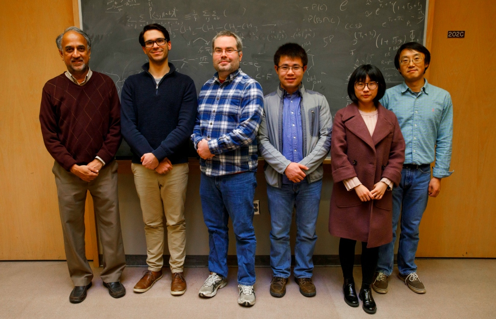 A team of Indiana University researchers and chemists who worked on a molecule that can turn carbon dioxide into carbon monoxide using light and electricity.