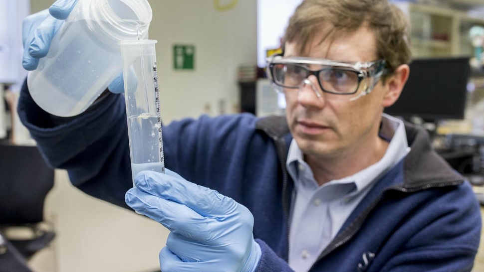 A researcher at Shedd Aquarium conducts tests as part of the Microbiome Project.