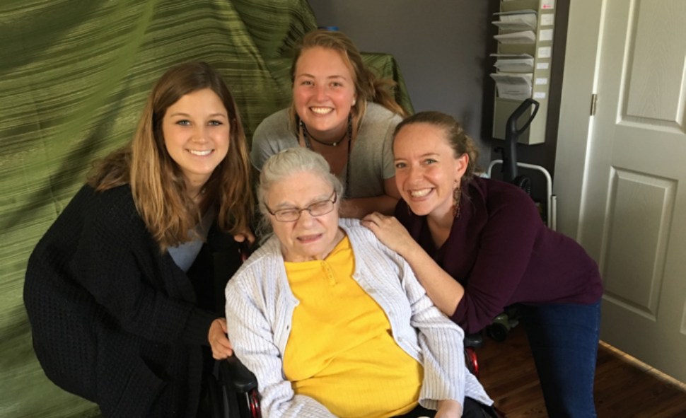 at The Better Day Club with one of our participants. Clockwise from left: Zoe Schrader, Anna Lubbers (both students), Dr. Jennie Gubner, and Joy.