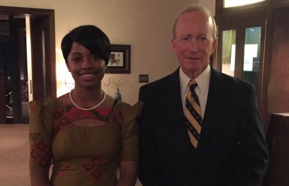 Purdue graduate Raven Osborne with University president Mitch Daniels