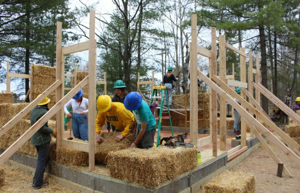 University of Michigan students constructing the Straw Bale House at the UM Biological Station.