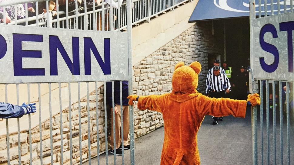 Penn State's mascot opens a gate at Beaver Stadium before a football game