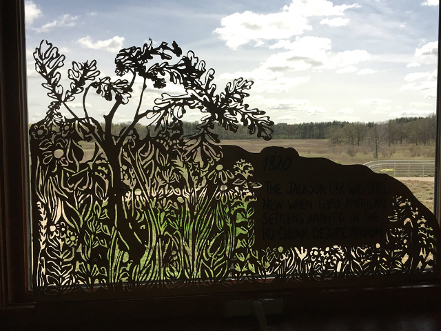 A laser-etched sign from University of Wisconsin artist Liz Anna Kozik's prairie exhibit.