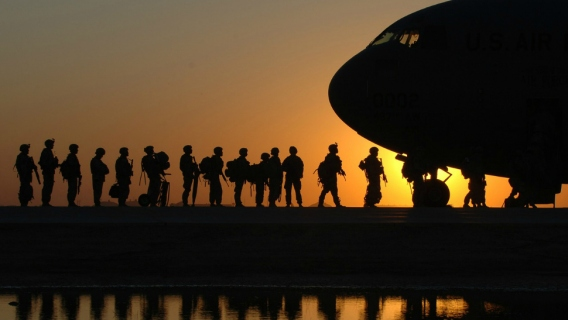 Soldiers on a military flight