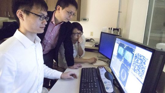 From left, doctoral student Haiguang Wen, assistant professor Zhongming Liu and former graduate student Junxing Shi, review fMRI data of brain scans. The work aims to improve artificial intelligence and lead to new insights into brain function. (Purdue University image/Erin Easterling)
