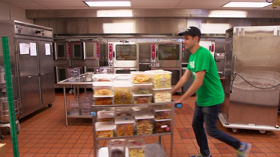 A student with Food Recovery Network, which was founded at the University of Maryland, packages unused food for distribution.