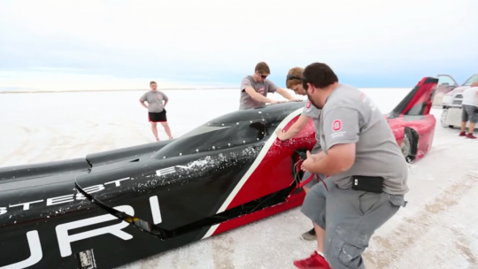 Student engineers and designers work on the Venturi Buckeye Bullet at the Bonneville Salt Flats