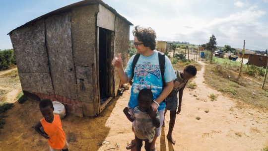 Intsikelelo co-founder Nick Gravas in South Africa with children