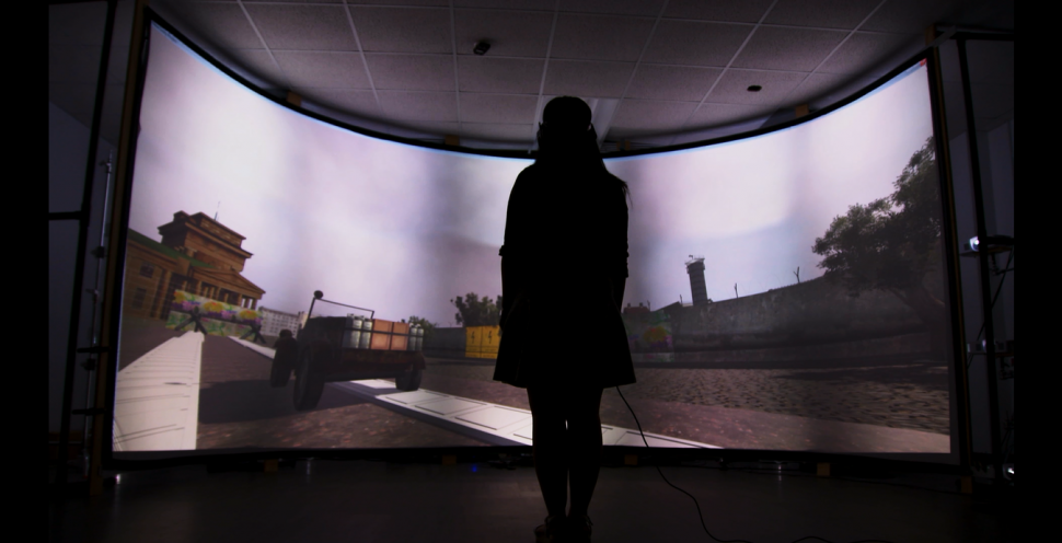 A visitor uses the Newseum's Virtual reality Berlin Wall exhibit designed by the University of Maryland developers.