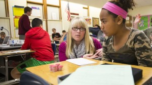 Megan Jorgensen, a University of Nebraska-Lincoln graduate, discusses a STEM problem with a student at Lincoln's Park Middle School in this file photo from 2014.