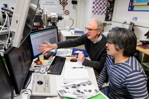 Geoscience Professor John Valley, left, and research scientist Kouki Kitajima collaborate in the Wisconsin Secondary Ion Mass Spectrometer Lab (WiscSIMS) in Weeks Hall at the University of Wisconsin-Madison on Dec. 15, 2017. Researchers J. William Schopf, professor of paleobiology at UCLA, and John W. Valley, professor of geoscience at UW-Madison, have confirmed that microscopic fossils discovered in a nearly 3.5 billion-year-old piece of rock in Western Australia are the oldest fossils ever found and indeed the earliest direct evidence of life on Earth. (Photo by Jeff Miller / UW-Madison)