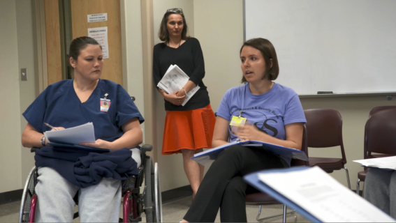 A University of Iowa student leads a group of women in the Healthy Relationships class at the Iowa Correctional Institute for Women.
