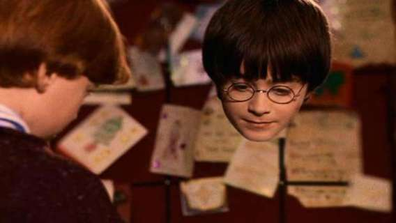 The character Harry Potter tries on an invisibility cloak in front of his bff Ron Weasley.