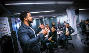 Neal Sales-Griffin in front of students at 1871 incubator in Chicago
