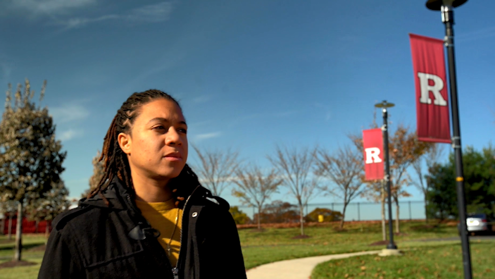 Rutgers University alumnae Danielle King walking on the New Brunswick campus