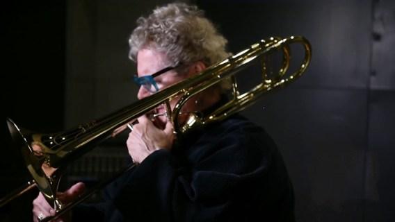 Michigan State University professor Ava Ordman playing the trombone