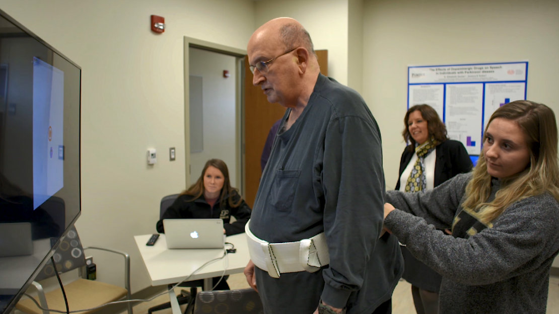 Patient Carl Stafford plays a therapy game during a Parkinson's Disease study at Purdue University