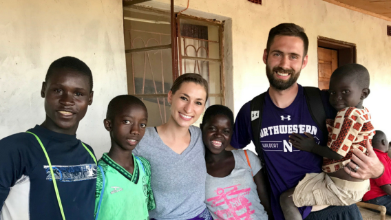 Northwestern University's Tad and Karly Glibert in Malawi with residents.