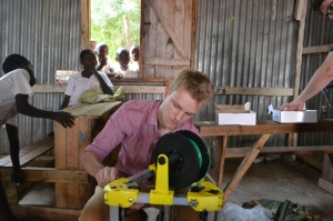 A Penn State student working with the Kijenzi printer.