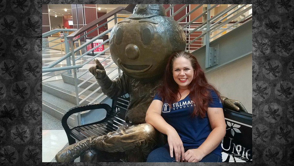Ohio State student-veteran Gretchen Klingler poses with a statue of Brutus Buckeye