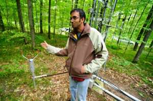 Ankur Desai, a University of Wisconsin Madison professor of atmospheric and oceanic sciences in front of a flux tower installed for a recent research project