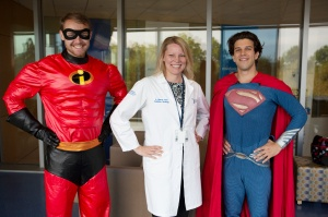 Penn State doctor Amy burns with medical students and members of the BraveCubs program dressed as superheroes Mr. Incredible and Superman