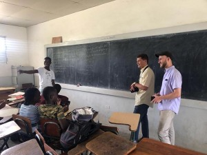 University of Maryland architecture students from Roots Home and Abroad talking with school children at the Leogane School in Haiti