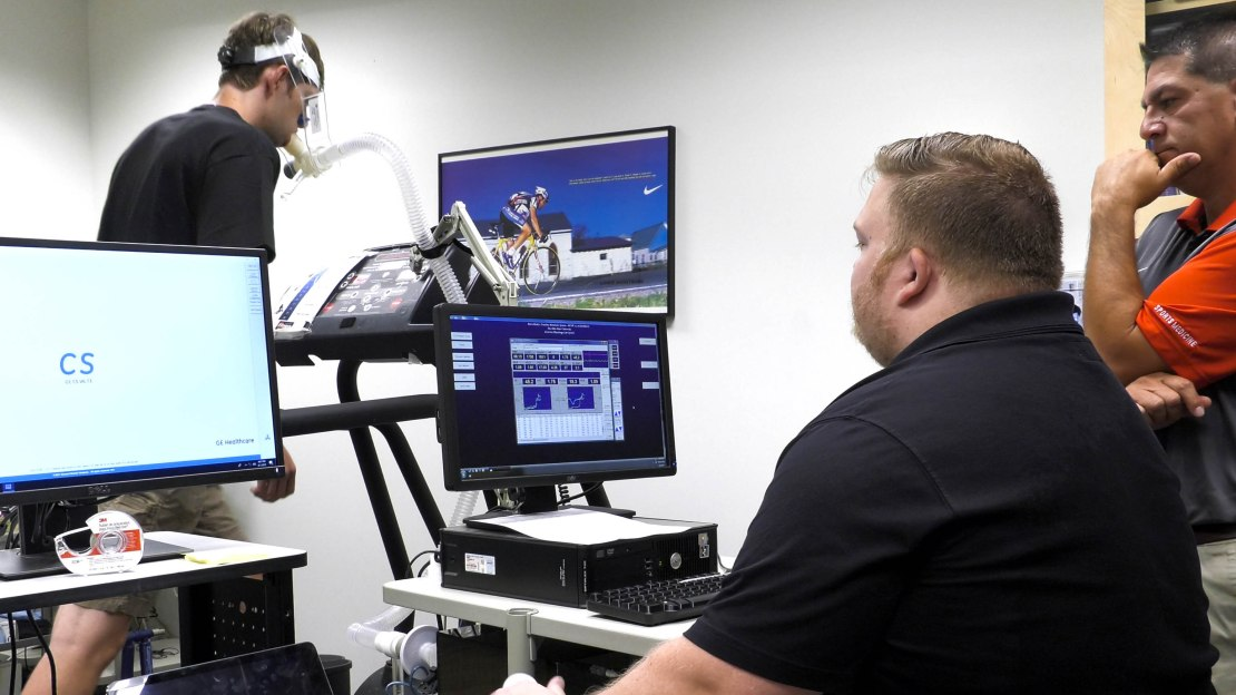an ohio state university esports athlete is hooked up to a machine on a treadmill in a lab for study