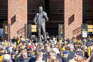 University of Iowa fans pass Nile Kinnick's statue as they enter Kinnick Stadium.