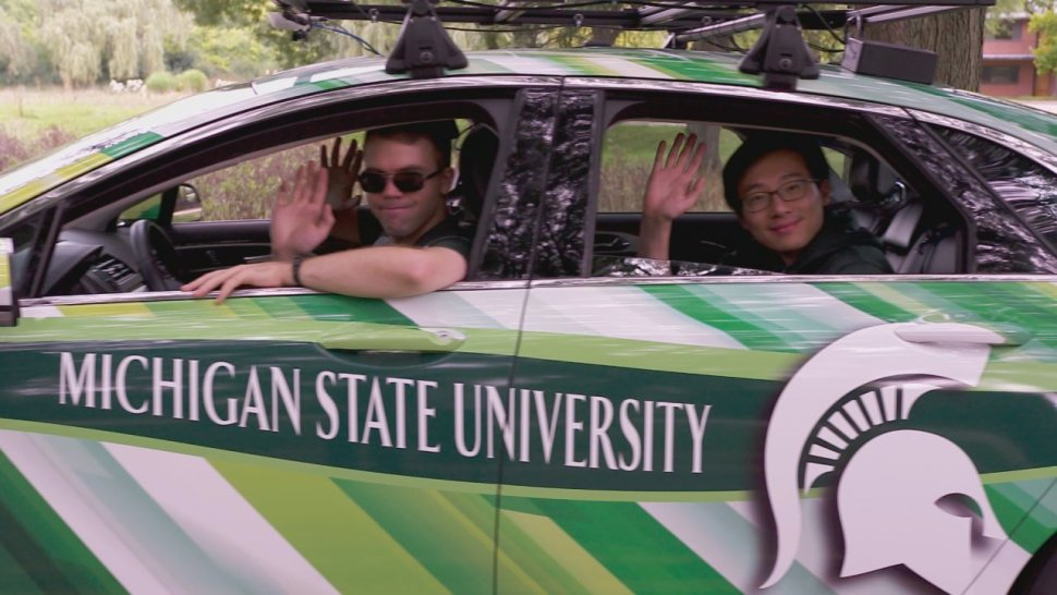 Researchers at Michigan State University take a ride in an autonomous driverless car that they are testing