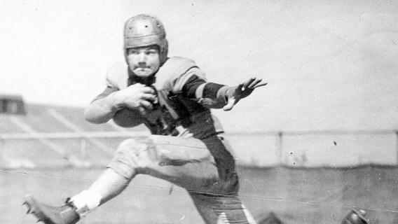 Nile C. Kinnick Jr. University of Iowa Hawkeyes football legend and winner of the 1939 Heisman Trophy, posing in his football uniform.