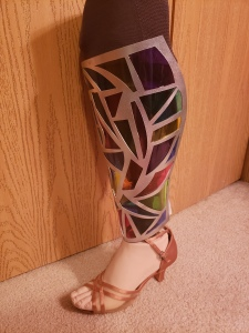 University of Iowa student and No Limbits founder Erica Cole's stained glass prosthetic leg cover.