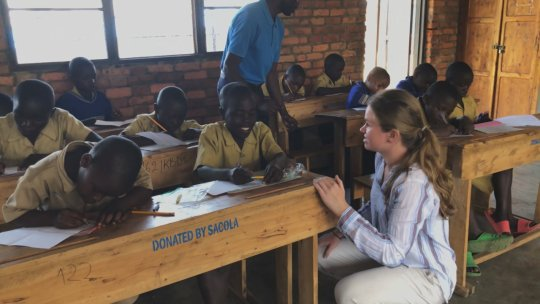 Indiana University students working as tutors in Rwanda for the Books and Beyond program