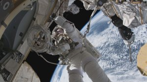 Astronaut and Purdue University alum Andrew Feustel performing a space walk outside the International Space Station.