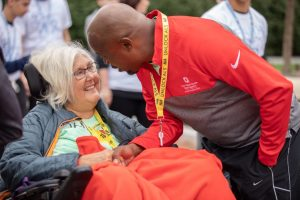 William White greets Jan Deringer Daily '80, his teammate on Jan's Fans and a fellow ALS patient, during the September Walk to Defeat ALS in downtown Columbus.