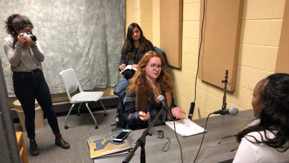 University of Michigan students conducting an interview for their podcast While We Were Away