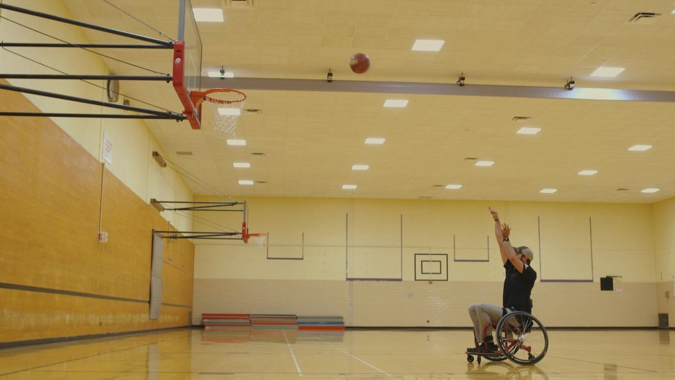 Evan David, president of the Indiana University Wheelchair Basketball Club shoots a free throw