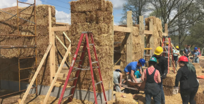 Students working on the University of Michigan's straw bale building