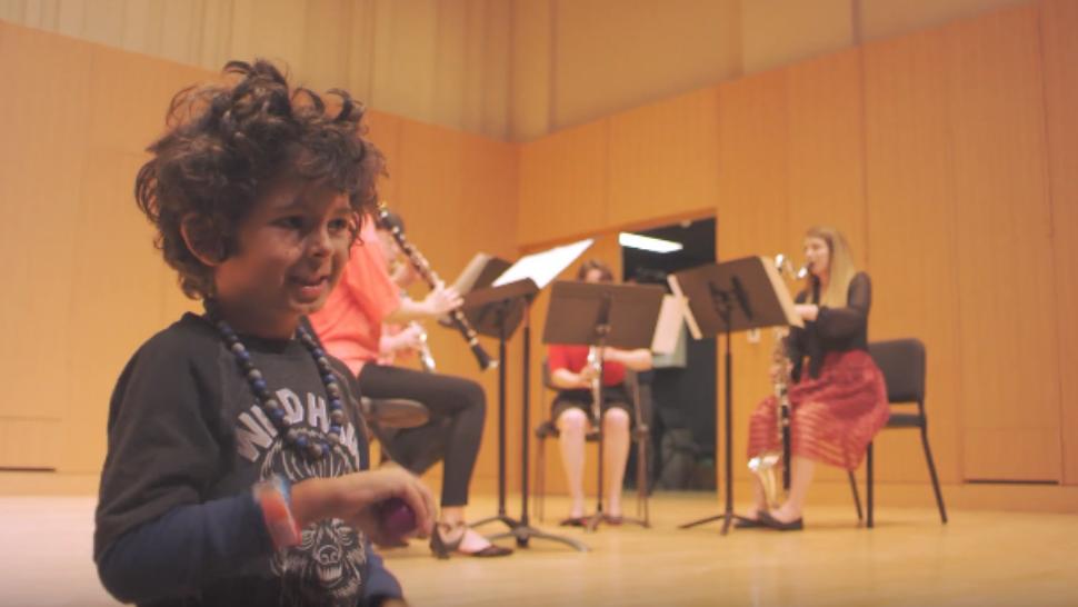 A child enjoys a Michigan State University Sensory Friendly Spartan Concert